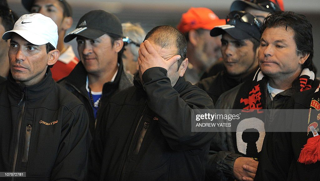 Chilean miner Mario Sepulveda reacts with fellow miners as they watch a short film about their escape during a visit to Manchester United's Old...