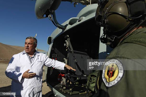 Chilean Minister of Health Jaime Manalich gives instructions during a put on of the rescue of the 33 miners trapped in San Jose mine near the city of...