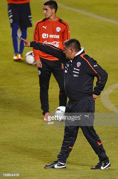 Chilean national football team coach Claudio Borghi gives instructions to his players during a training session in Quito on October 9 ahead of their...