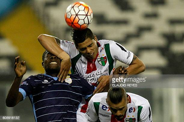 TOPSHOT Chilean Palestino's footballer Benjamin Vidal and Ezequiel Luna vies for the ball with Wilberto Cosme of Real Garcilaso of Peru during their...