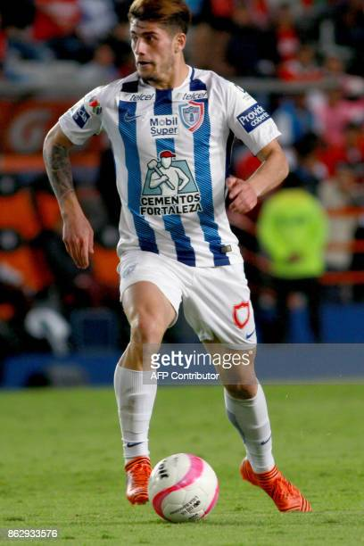 Chilean player Angelo Sagal of Pachuca runs with the ball during their Mexican Apertura tournament football match against Toluca at the Hidalgo...