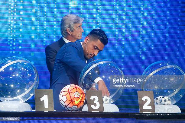 Chilean player Gonzalo Jara takes a ball from the raffle drum during the Copa Total Sudamericana Draw at Espacio Riesco on July 12 2016 in Santiago...