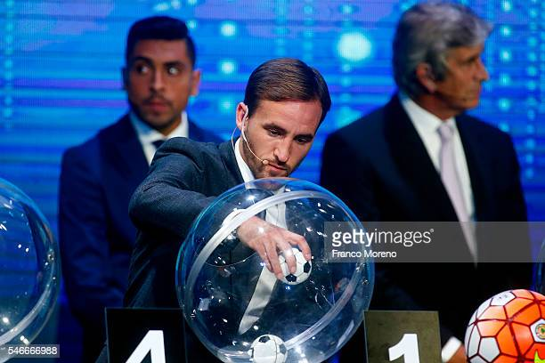 Chilean player Pedro Fuenzalida takes a ball from the raffle drum during the Copa Total Sudamericana Draw at Espacio Riesco on July 12 2016 in...