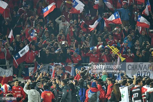 Chilean players and fans celebrate after winning the 2015 Copa America football championship final against Argentina in Santiago Chile on July 4 2015...