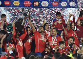 Chilean players celebrate after winning the 2015 Copa America football championship final against Argentina in Santiago Chile on July 4 2015 Chile...