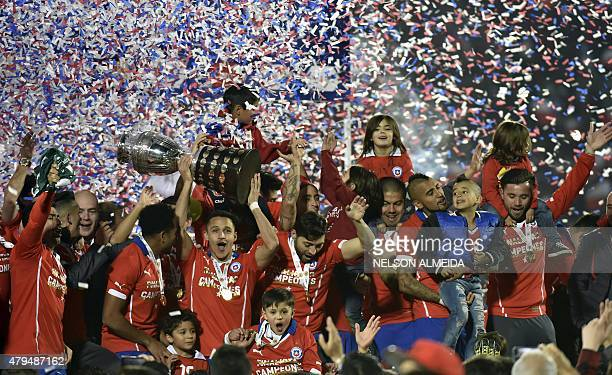 Chilean players celebrate with the trophy of the 2015 Copa America football championship in Santiago Chile on July 4 2015 AFP PHOTO / NELSON ALMEIDA