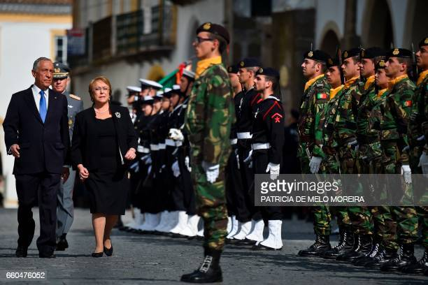 Chilean President Michelle Bachelet and Portuguese President Marcelo Rebelo de Sousa inspect the Honour Guard troops upon her arrival at Giraldo...