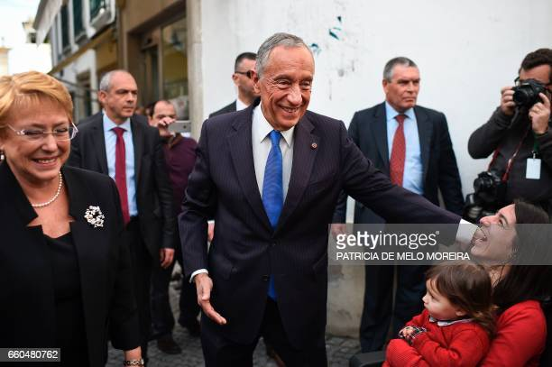 Chilean President Michelle Bachelet and Portuguese President Marcelo Rebelo de Sousa cheers locals as they walk the streets of Evora Alentejo on...