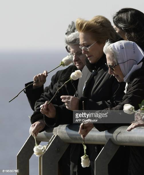 Chilean President Michelle Bachelet and Vera Jarach fromde Madres de Plaza de Mayo human rights organization throw flowers into the waters of the...