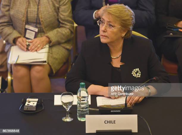 Chilean President Michelle Bachelet attends the Global Conference on Noncommunicable diseases at Mercosur headquarters in Montevideo on October 18...