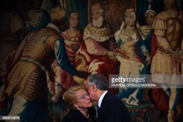 Chilean President Michelle Bachelet kisses Portuguese President Marcelo Rebelo de Sousa at the end of a joint press conference at Sao Miguel Palace...