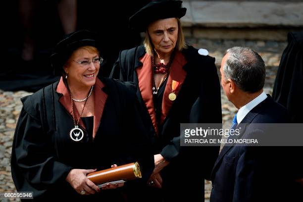 Chilean President Michelle Bachelet leaves accompanied by Evora's University Dean Ana Costa Freitas and Portuguese President Marcelo Rebelo de Sousa...