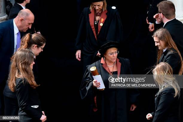 Chilean President Michelle Bachelet leaves accompanied by Evora's University Dean Ana Costa Freitas after she received her Honoris Causa degree...