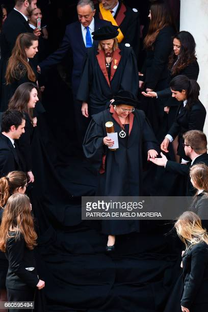 Chilean President Michelle Bachelet leaves followed by Evora's University Dean Ana Costa Freitas and Portuguese President Marcelo Rebelo de Sousa...