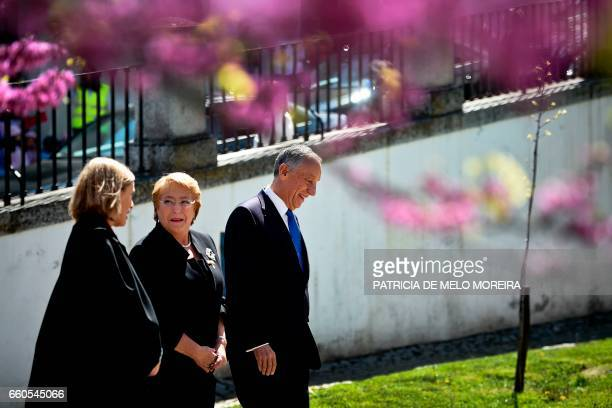 Chilean President Michelle Bachelet walks flanked by Portuguese President Marcelo Rebelo de Sousa and and Evora University's Dean Ana Costa Freitas...