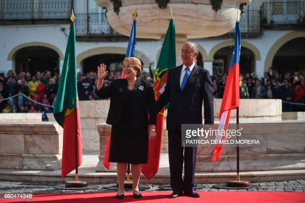Chilean President Michelle Bachelet waves as she is welcomed by Portuguese President Marcelo Rebelo de Sousa upon her arrival at Giraldo square in...
