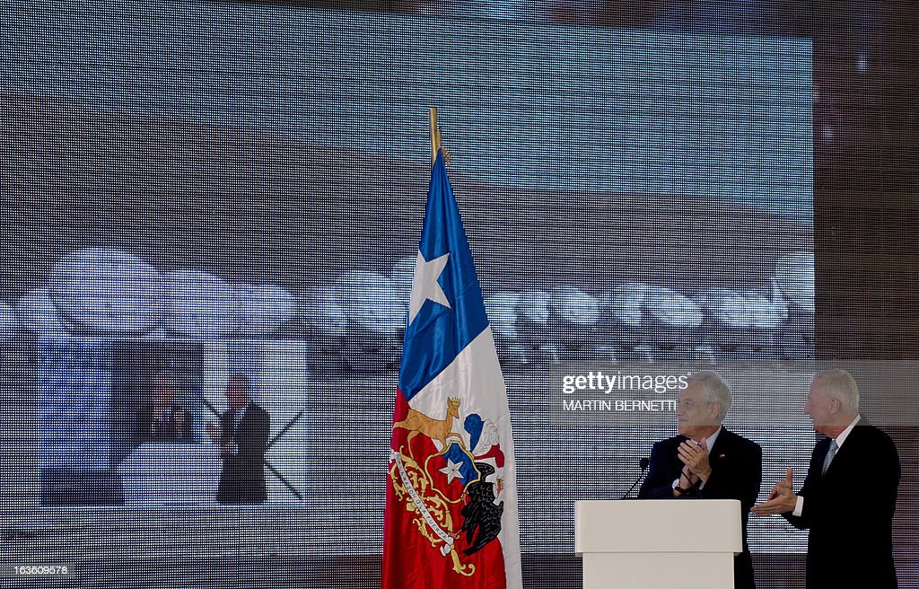 Chilean President Sebastian Pinera (L) and ALMA Director Thijs De Graauw (R) participate in the inauguration of the ALMA Observatory (Atacama Large Millimeter/submillimeter Array) in the San Pedro de Atacama , some 1500 km north of Santiago, on March,13,2013. The ALMA, an international partnership project of Europe, North America and East Asia with the cooperation of Chile, is presently the largest astronomical project in the world. Today will be opened 59 of 66 high precision antennas, located at 5000 of altitude in the extremely arid Atacama desert. AFP PHOTO/Martin BERNETTI
