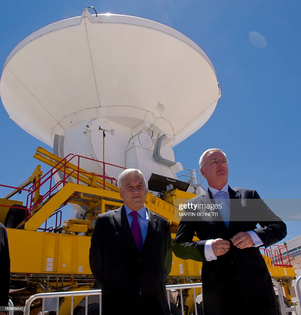 Chilean President Sebastian Pinera (L) and General Director ESO, Tim De Zeeuw take part in the inauguration of the ALMA Observatory ( Atacama Large Millimeter/submillimeter Array) in the San Pedro de Atacama , some 1500 km north of Santiago, on March,13,2013. The ALMA, an international partnership project of Europe, North America and East Asia with the cooperation of Chile, is presently the largest astronomical project in the world. Today will be opened 59 of 66 high precision antennas, located at 5000 of altitude in the extremely arid Atacama desert. AFP PHOTO/Martin BERNETTI