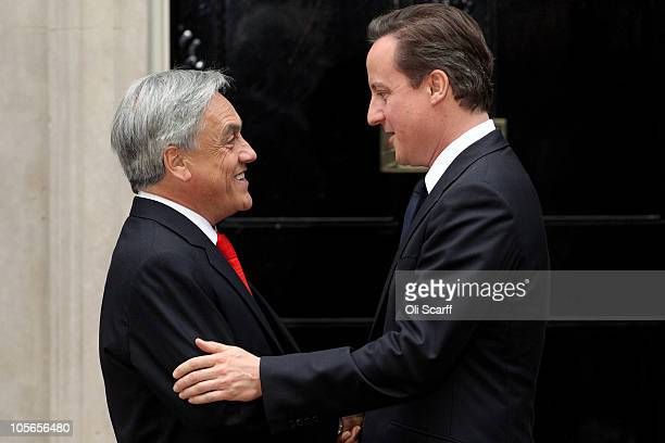 Chilean President Sebastian Pinera is greeted by British Prime Minster David Cameron outside number 10 Downing Street on October 18 2010 in London...