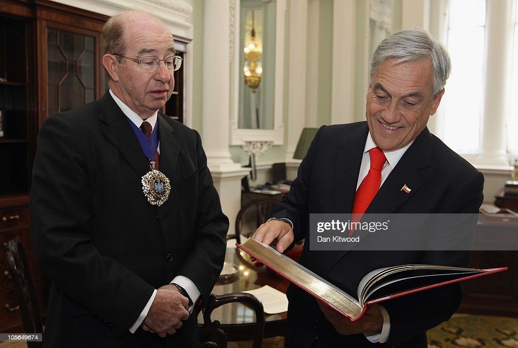 Chilean President Sebastian Pinera is presented with a book called MAnsion House by Sally Jeffrey, by City of London's Lord Mayor Locum Tenens Lord Levene, at Mansion House on October 18, 2010 in London, England. Mr Pinera who is currently on a European tour, is due to meet HRH Queen Elizabeth II later today. The President is due to present Her Majesty with a rock from the Chilean mine where 33 men were trapped for more than two months before their dramatic rescue last week.