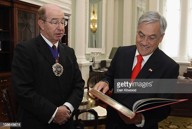 Chilean President Sebastian Pinera is presented with a book called MAnsion House by Sally Jeffrey by City of London's Lord Mayor Locum Tenens Lord...