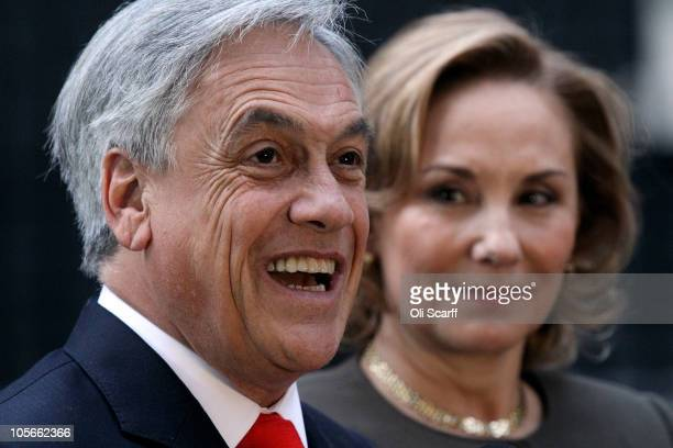 Chilean President Sebastian Pinera stands with his wife Cecilia Morel and talks to reporters after meeting British Prime Minister David Cameron in...