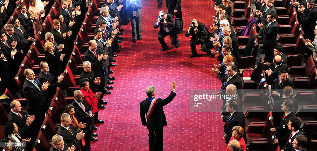 Chilean President Sebastian Pinera waves to congressman during his arrival at the Congress before his annual presidential message to the Nation in Valparaiso on May 21, 2010. AFP PHOTO / Claudio Santana