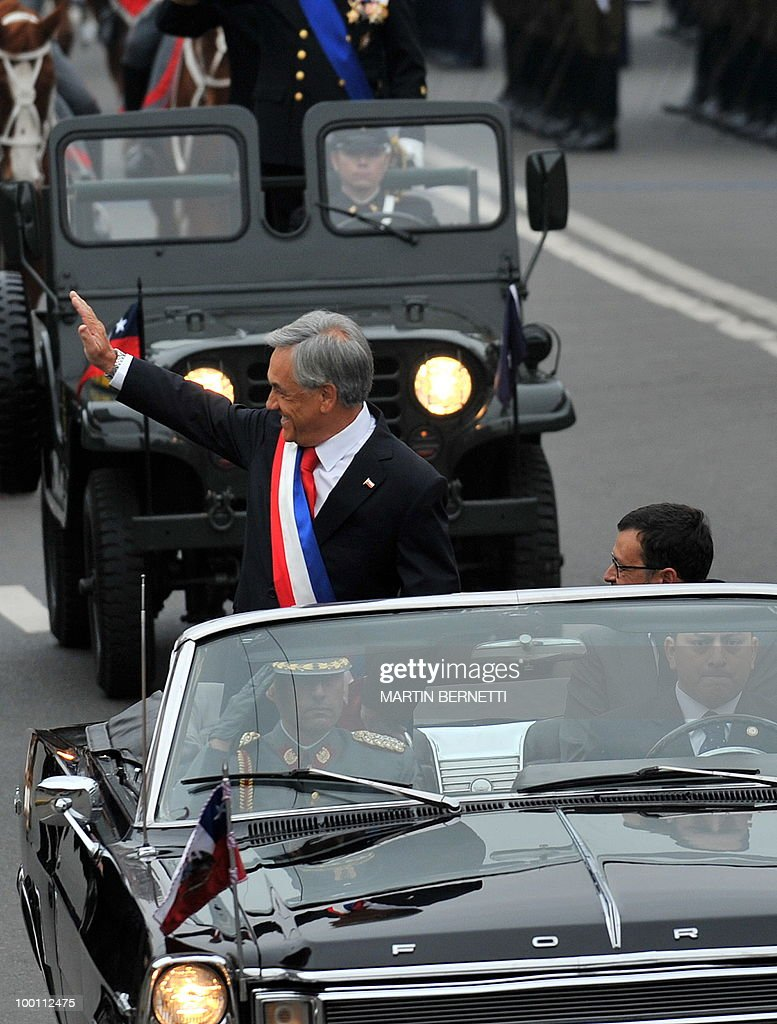 Chilean President Sebastian Pinera waves to public as he arrives at the National Congress to give his annual message to the nation, in Valparaiso on May 21, 2010.