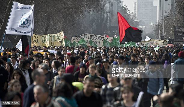 Chilean teachers and students march during a protest to demand to Chilean President Michelle Bachelet's government to improve the public education...