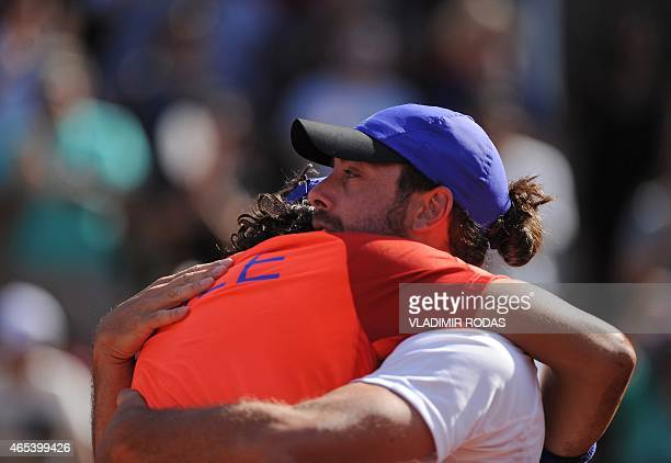 Chilean tennis player Christian Garin celebrates with Chile's Davis Cup team captain Nicolas Massu after defeating Peruvian Duilio Beretta during the...