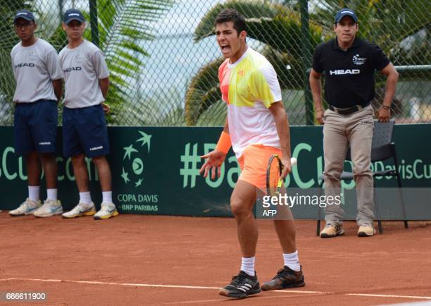 Chilean tennis player Christian Garin reacts upon losing to Colombia's Santiago Giraldo their Davis Cup match in Medellin Colombia on April 9 2017 /...