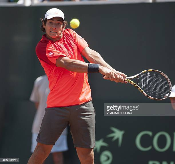 Chilean tennis player Christian Garin returns de ball during his Davis Cup Americas Zone Group II match against Peruvian player Duilio Beretta held...