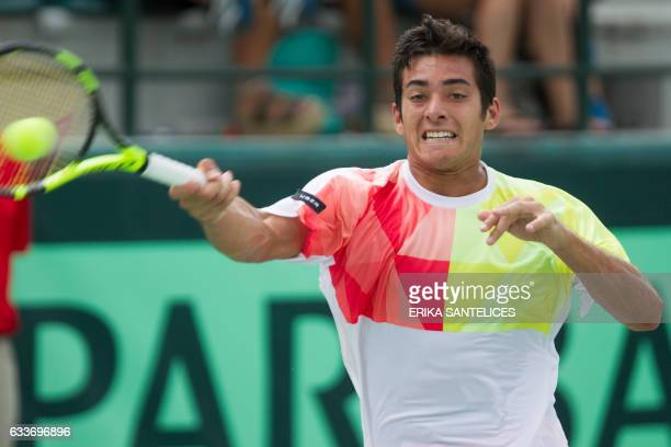 Chilean tennis player Christian Garin returns the ball to Dominican player Roberto Cid during their Davis Cup World Group second round singles tennis...
