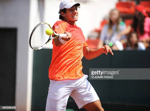 Chilean tennis player Christian Garin returns the ball to Peruvian Duilio Beretta during the first round of the Davis Cup Americas Zone Group II in...