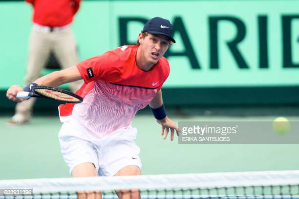 Chilean tennis player Nicolas Jarry returns the ball to Dominican tennis player Nick Hardt during the Davis World Cup fifth singles tennis match...