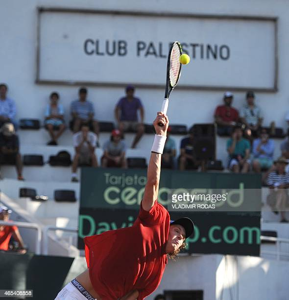 Chilean tennis player Nicolas Jarry serves during his Copa Davis match against Peruvian Pablo Varillas in Santiago on March 6 2015 AFP PHOTO/Vladimir...