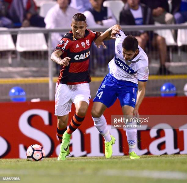 Chilean Universidad Catolica Alfonso Parot vies for the ball with Flamengo's Paolo Guerrero during their Copa Libertadores football match on March 15...