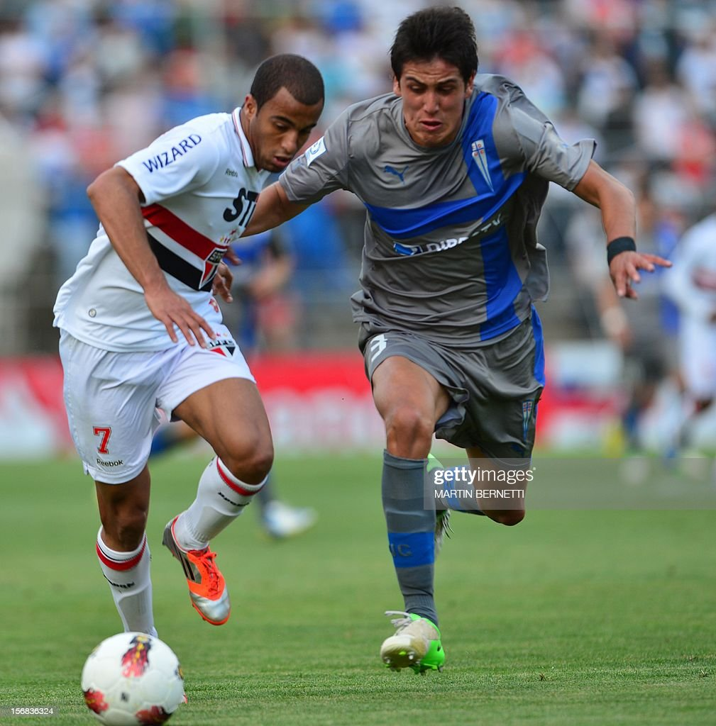 Chilean Universidad Catolica's Enzo Andia (R) vies for the ball with Brazilian Sao Paulo's Lucas Moura (L) during their 2012 Copa Sudamericana first leg semifinal football match at San Carlos de Apoquindo stadium in Santiago, Chile, November 22, 2012.
