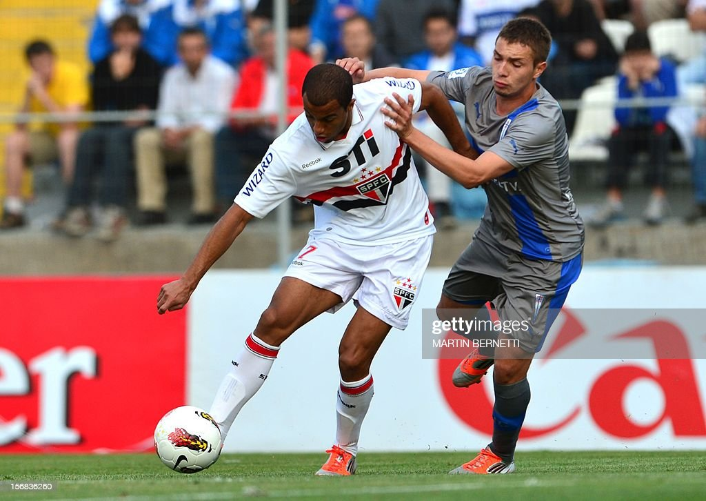 Chilean Universidad Catolica's footballer Claudio Sepulveda (R) vies for the ball with Brazilian Sao Paulo's Lucas Moura during their 2012 Copa Sudamericana first leg semifinal football match at San Carlos de Apoquindo stadium in Santiago, Chile, November 22, 2012.