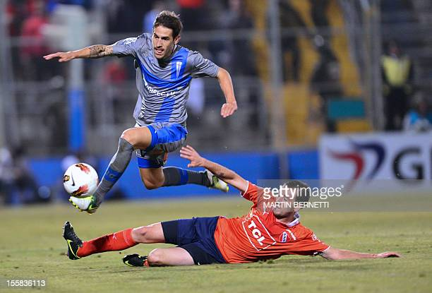 Chilean Universidad Catolica's Tomas Costa vies for the ball with Argentinian Independiente's Federico Mancuello during their Copa Sudamericana 2012...