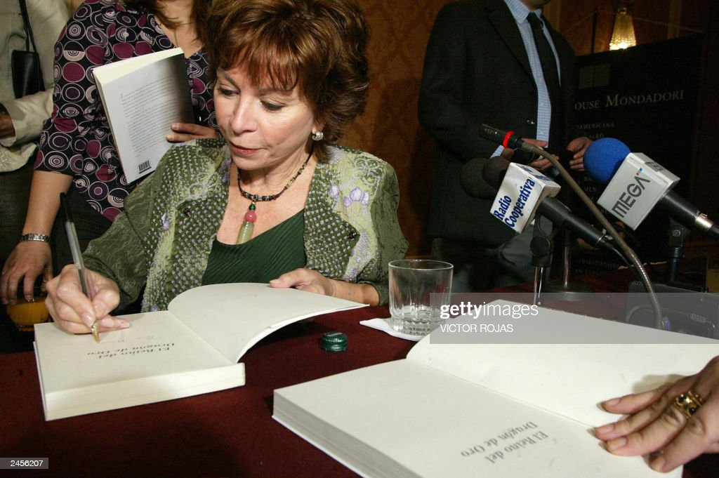 Chilean writer Isabel Allende autographs copies of her most recent book at the end of a press conference to promote it 02 September, 2003 in Santiago. Allende launched Tuesday 'The kingdom of the golden dragon' (El reino del dragon de oro), second part of her trilogy for the young initiated with 'The city of the beasts' (La ciudad de las bestias) AFP PHOTO/Victor ROJAS