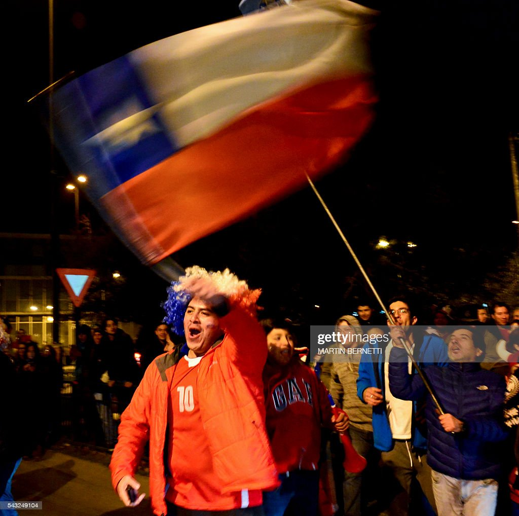 Chileans celebrate victory over Argentina in the final match of the Copa America Centenario 2016 in Santiago, Chile, June 26, 2016. Holders Chile stunned Argentina to win the Copa America Centenario in a penalty shoot-out as Lionel Messi's title curse struck again. It was a carbon copy of last year's Copa America final, also won by Chile on penalties after a goalless draw. / AFP / MARTIN