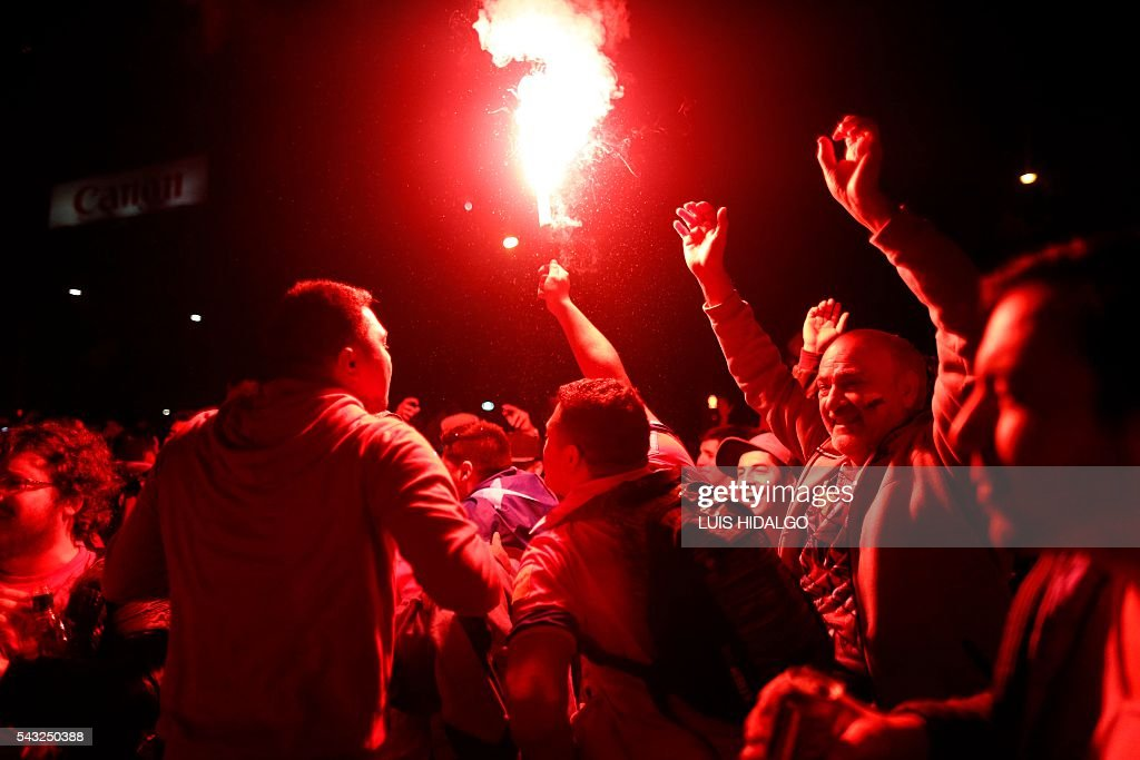 Chileans celebrate victory over Argentina in the final match of the Copa America Centenario 2016 in Santiago, Chile, June 26, 2016. Holders Chile stunned Argentina to win the Copa America Centenario in a penalty shoot-out as Lionel Messi's title curse struck again. It was a carbon copy of last year's Copa America final, also won by Chile on penalties after a goalless draw. / AFP / LUIS