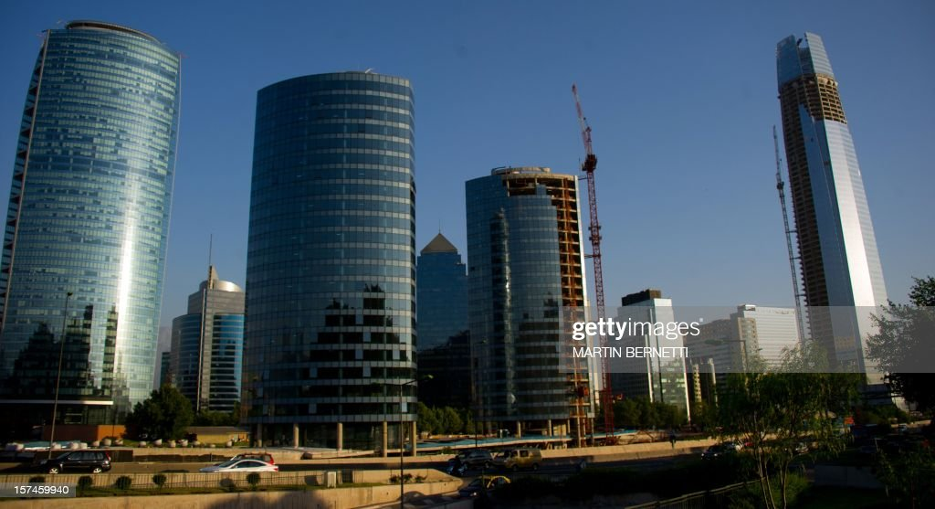 Chile-architecture-business,FEATURE by Paulina Abramovich View of the Gran Torre Costanera Center building (R) under construction, the tallest in South America, in Santiago, on November 20, 2012. The 300-metre-high tower was designed by Argentine architect Cesar Pelli, who designed the Petronas Towers in Kuala Lumpur.