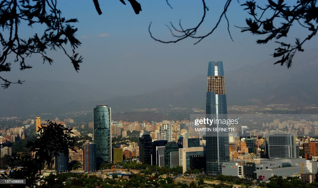 Chile-architecture-business,FEATURE by Paulina Abramovich View of the Gran Torre Costanera Center building under construction (R), the tallest in South America, in Santiago, on November 20, 2012. The 300-metre-high tower was designed by Argentine architect Cesar Pelli, who designed the Petronas Towers in Kuala Lumpur.