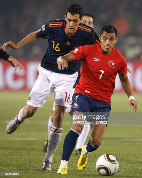 Chile's Alexis Sanchez and Spain's Sergio Busquets battle for the ball