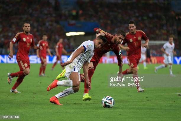 Chile's Alexis Sanchez and Spain's Sergio Ramos battle for the ball