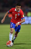Chile's Alexis Sanchez drives the ball during their Russia 2018 FIFA World Cup qualifiers match against Brazil at the Nacional stadium in Santiago de...