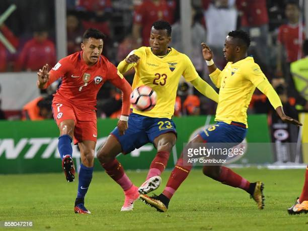 Chile's Alexis Sanchez is marked by Ecuador's Dario Aimar and Ecuador's Renato Ibarra during their 2018 World Cup qualifier football match in...