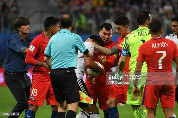Chile's and Germany's player argue for the ball during the 2017 Confederations Cup final football match between Chile and Germany at the Saint...